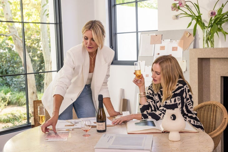 Cameron Diaz and Katherine Power discuss Avaline wine at a table